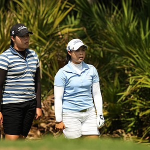Moriya Jutanugarn, right, with her sister Ariya, left, discuss a shot at No. 10 during the first day of LPGA Qualifying School at LPGA International.