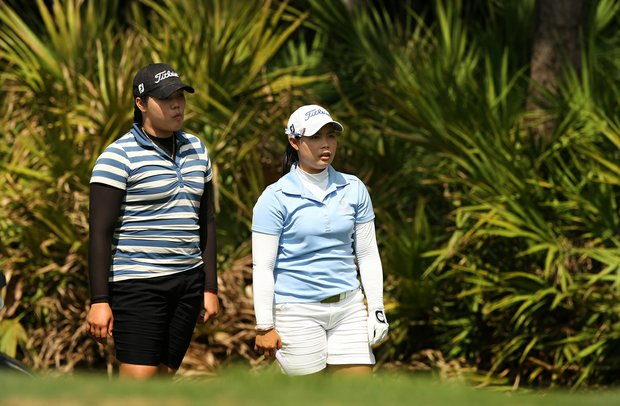Moriya Jutanugarn, right, with her sister Ariya, left, discuss a shot at No. 10 during the first day of LPGA Qualifying School at LPGA International.