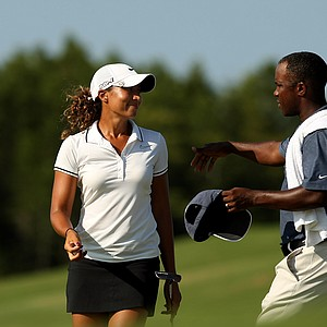Cheyenne Woods gets a hug from her caddie Reynolds Robinson during the first day of LPGA Qualifying School at LPGA International.