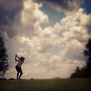 Cheyenne Woods is silhouetted at No. 18 tee during the first day of LPGA Qualifying School at LPGA International.