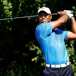Tiger Woods watches his tee shot on the 15th hole during the first round of the BMW Championship at Crooked Stick Golf Club on September 6, 2012 in Carmel, Indiana.