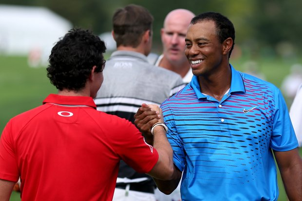 Tiger Woods shakes hands with Rory McIlroy on their final hole during the first round of the BMW Championship at Crooked Stick Golf Club.