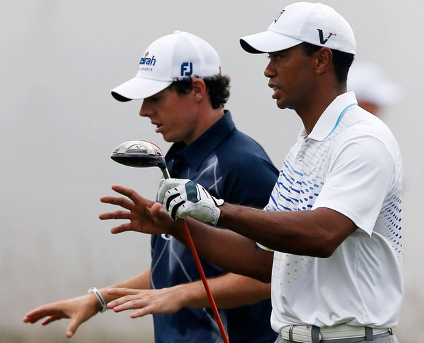 Rory McIlroy and Tiger Woods during the second round of the BMW Championship at Crooked Stick Golf Club.