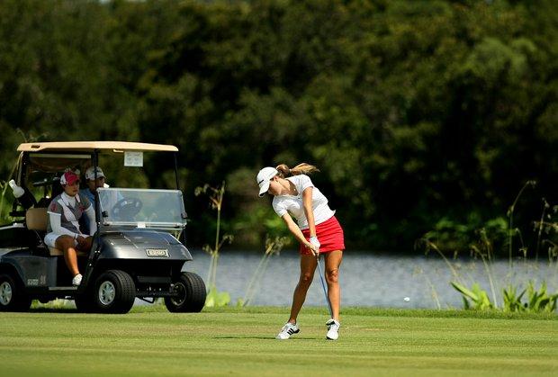 Jaye Marie Green hits a shot at No. 18 from the fairway.