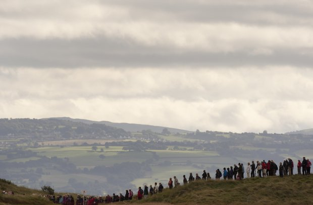 Spectators stand on a hill to watch the Womenís British Open golf championships at Royal Liverpool Golf Club, Hoylake, England.