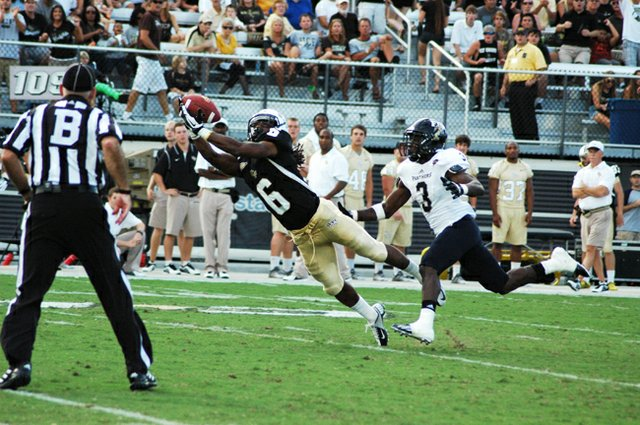 UCF receiver Rannell Hall leaps to catch a pass from quarterback Blake Bortles. Hall picked up 63 yards receiving and 93 yards on kickoff returns in the Knights&#39; 33-20 win over Florida International University. 