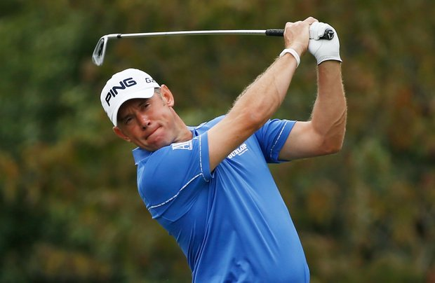Lee Westwood watches his tee shot on the second hole during the first round of the Tour Championship.