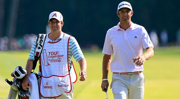 Dustin Johnson and his caddie Cameron Hooper walk up the 17th hole during the second round of the Tour Championship at East Lake Golf Club on Sept. 21, 2012 in Atlanta.