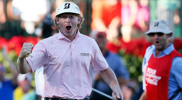 Brandt Snedeker celebrates on the 18th green after his three-stroke victory at the Tour Championship to clinch the FedEx Cup.