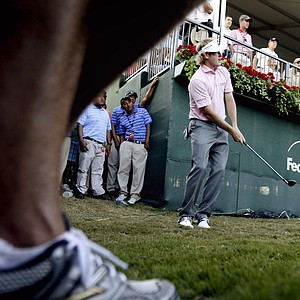Brandt Snedeker chips onto the green after taking a drop from hitting his tee shot into the stands on the 18th hole during the final round of the Tour Championship golf tournament, Sunday, Sept. 23, 2012, in Atlanta. (AP Photo/David Goldman)