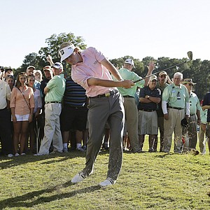 Brandt Snedeker hits from the rough on the 17th hole during the final round of play in the Tour Championship golf tournament in Atlanta, Sunday, Sept. 23, 2012. Snedeker won the tournament and the FedEx Cup. (AP Photo/John Bazemore)