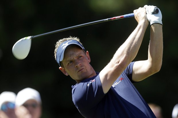 Luke Donald, of England, tees off on the ninth hole during the final round of play in the Tour Championship golf tournament in Atlanta, Sunday, Sept. 23, 2012. (AP Photo/John Bazemore)