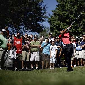 Tiger Woods hits out of the rough off the fairway of the fourth hole during the final round of the Tour Championship golf tournament Sunday, Sept. 23, 2012, in Atlanta. (AP Photo/David Goldman)