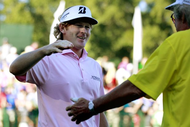 Brandt Snedeker, left, embraces his father Larry after winning the Tour Championship golf tournament and the FedEx Cup, Sunday, Sept. 23, 2012, in Atlanta. (AP Photo/David Goldman)