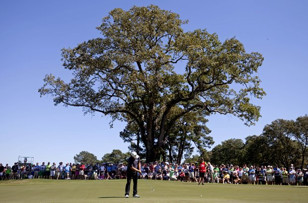 Ryan Moore putts on the fourth hole during the final round of the Tour Championship golf tournament Sunday, Sept. 23, 2012, in Atlanta. (AP Photo/David Goldman)