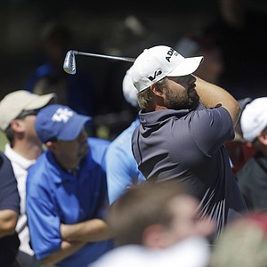 Ryan Moore watches his tee shot on the second hole during the final round of play in the Tour Championship golf tournament in Atlanta, Sunday, Sept. 23, 2012. (AP Photo/John Bazemore)