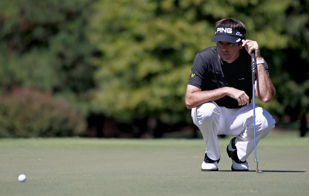 Bubba Watson eyes his putt on the fourth hole during the final round of the Tour Championship on Sunday, Sept. 23, 2012, in Atlanta.