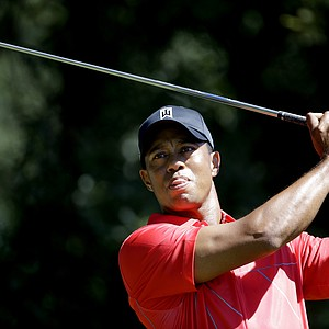 Tiger Woods tees off the third hole during the final round of the Tour Championship golf tournament Sunday, Sept. 23, 2012, in Atlanta. (AP Photo/David Goldman)