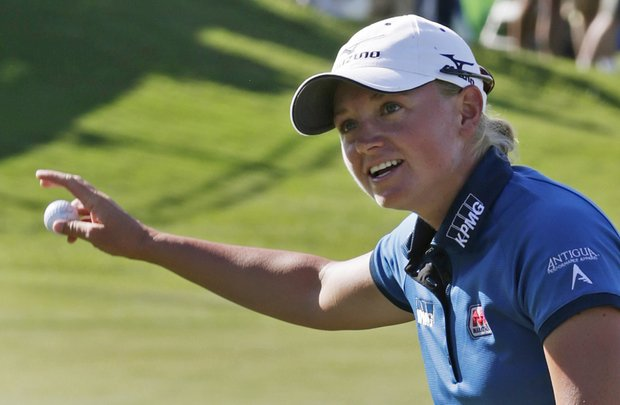 Stacy Lewis reacts after winning the Navistar LPGA Classic golf tournament, Sunday, Sept. 23, 2012, at the Robert Trent Jones Golf Trail in Prattville, Ala. (AP Photo/Dave Martin)