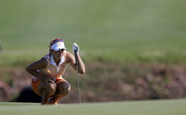 Lexi Thompson lines up her putt on the 17th green during second round play in the Navistar LPGA Classic golf tournament, Friday, Sept. 21, 2012, at the Robert Trent Jones Golf Trail in Prattville, Ala. (AP Photo/Dave Martin)