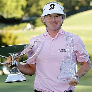 Brandt Snedeker poses with the trophies after winning the Tour Championship and FedEx Cup in Atlanta, Sunday, Sept. 23, 2012. (AP Photo/John Bazemore)
