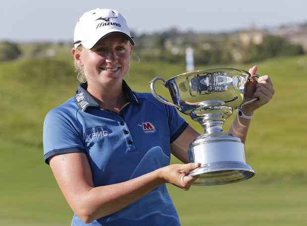 Stacy Lewis reacts with the trophy after winning the Navistar LPGA Classic golf tournament, Sunday, Sept. 23, 2012, at the Robert Trent Jones Golf Trail in Prattville, Ala. (AP Photo/Dave Martin)