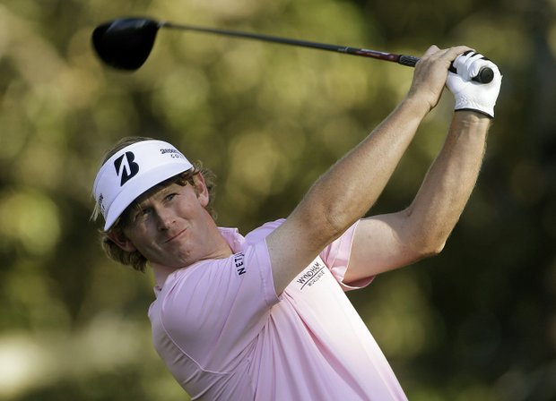 Brandt Snedeker hits his tee shot on the 13th hole during the final round of play in the Tour Championship golf tournament in Atlanta, Sunday, Sept. 23, 2012. Snedeker won the tournament. (AP Photo/John Bazemore)