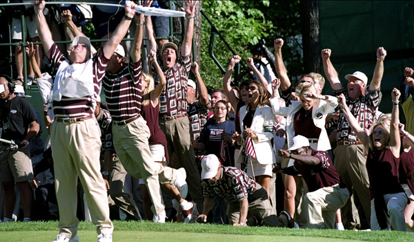 The American players and wives celebrate after Justin Leonard sinks a long birdie putt on the 17th green during the final day of the 33rd Ryder Cup at Brookline Country Club.