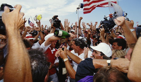 Payne Stewart pours champagne over team mate Hale Irwin after victory in the Ryder Cup at Kiawah Island in South Carolina.