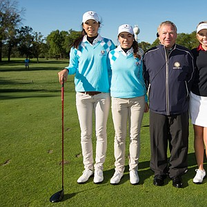 Referee Charlie Lanzetta poses with Harang Lee and Covadonga Sanjuan of the European Team, Casey Danielson and Karen Chung of the United States Team during the morning foursomes for the 8th Junior Ryder Cup at Olympia Fields Country Club on September 24, 2012 in Olympia Fields, Illinois.