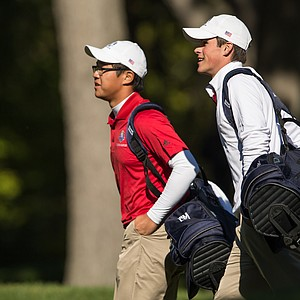 Jim Liu and Gavin Hall of the United States Team walk across the fairway during the morning foursomes for the 8th Junior Ryder Cup at Olympia Fields Country Club on September 24, 2012 in Olympia Fields, Illinois. (Photo by Mike Ehrmann/Getty Images for The PGA of America)