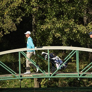 Victor Tornstrom and Renato Paratore of the European Team walk across a bridge during the morning foursomes for the 8th Junior Ryder Cup at Olympia Fields Country Club on September 24, 2012 in Olympia Fields, Illinois.