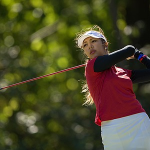 Alison Lee of the United States Team tees off of the seventh during the morning foursomes for the 8th Junior Ryder Cup at Olympia Fields Country Club on September 24, 2012 in Olympia Fields, Illinois.