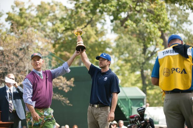 Actor Bill Murray and actor/singer and Ryder Cup Ambassador Justin Timberlake joke with the spectators during the Past Captains/Celebrity Scramble.