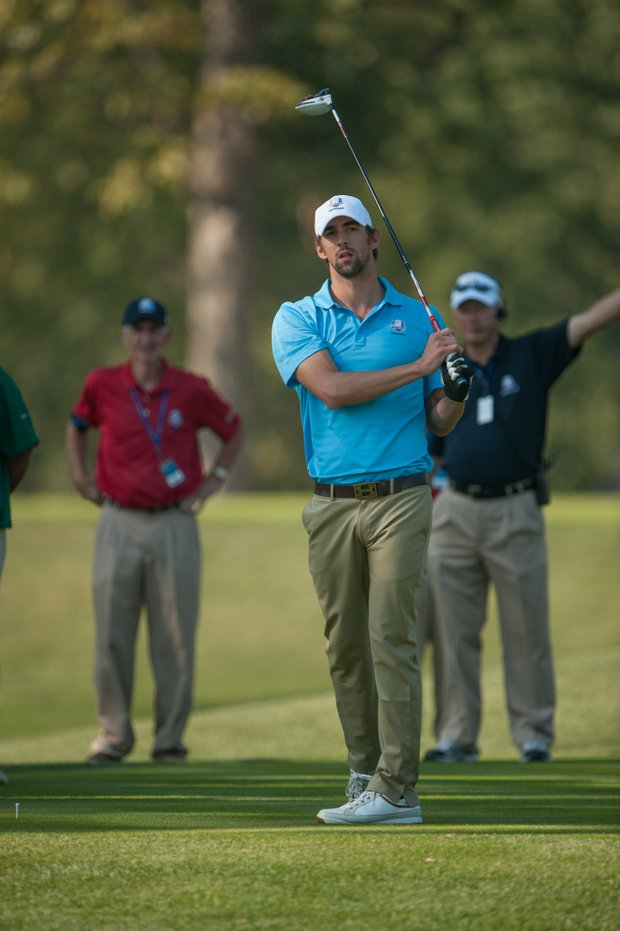 Olympic swimmer Michael Phelps plays a shot at Medinah Country Club for the Past Captains/Celebrity Scramble.
