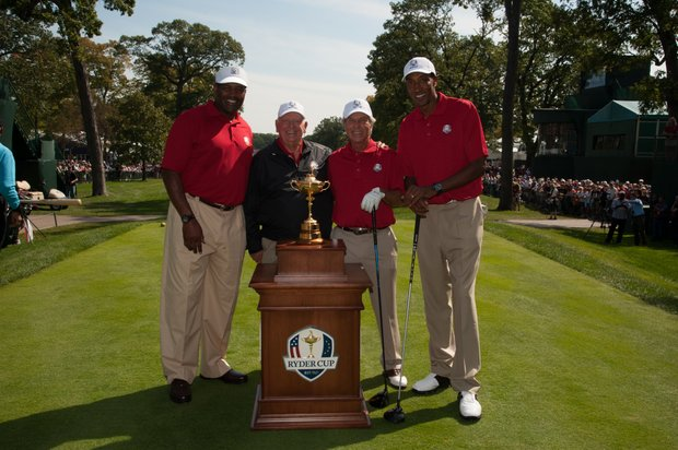 Chicago Cubs legend Ernie Banks, former Chicago Bears football player Richard Dent, Past Captain Billy Casper, Past Captain Ben Crenshaw, and basketball legend Scottie Pippen pose for a photo with the ryder cup before the Past Captains/Celebrity Scramble at Medinah Country Club.