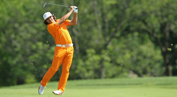 Rickie Fowler wearing one of his many color-coordinated pair of Puma shoes.