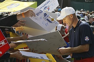 USA's Jim Furyk signs autographs at the Ryder Cup PGA golf tournament Wednesday, Sept. 26, 2012, at the Medinah Country Club in Medinah, Ill.
