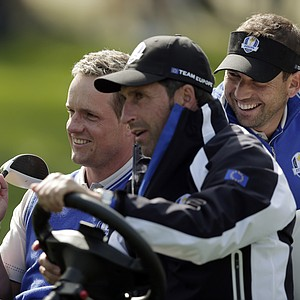 European team captain Jose Maria Olazabal talks to Luke Donald, left, and Sergio Garcia on the fourth hole during a practice round at the Ryder Cup PGA golf tournament Wednesday, Sept. 26, 2012, at the Medinah Country Club in Medinah, Ill.