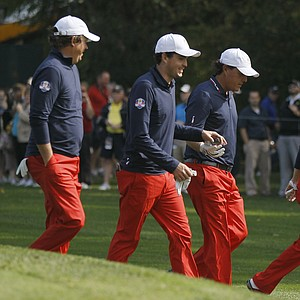 USA's Jason Dufner, left to right, Keegan Bradley, Phil Mickelson and Zach Johnson make their way off the fifth tee during a practice round at the Ryder Cup PGA golf tournament Wednesday, Sept. 26, 2012, at the Medinah Country Club in Medinah, Ill.