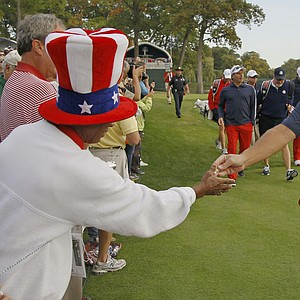 USA's Phil Mickelson hands fan Richard Atkins a pin after teeing off on the second hole at the Ryder Cup PGA golf tournament Wednesday, Sept. 26, 2012, at the Medinah Country Club in Medinah, Ill.