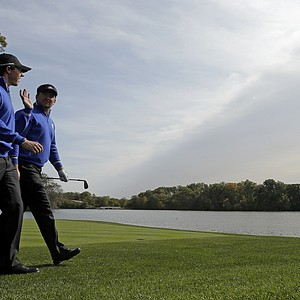 Europe's Rory McIlroy, left, and Graeme McDowell chat during a practice round at the Ryder Cup PGA golf tournament Wednesday, Sept. 26, 2012, at the Medinah Country Club in Medinah, Ill.