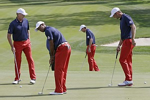 USA's Steve Stricker, left to right, Tiger Woods, Matt Kuchar and Dustin Johnson putt during a practice round at the Ryder Cup PGA golf tournament Wednesday, Sept. 26, 2012, at the Medinah Country Club in Medinah, Ill.