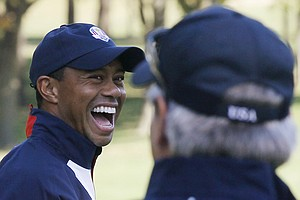 USA's Tiger Woods, left, laughs as he talks to Fred Couples at the Ryder Cup Thursday, Sept. 27, 2012, at the Medinah Country Club in Medinah, Ill.