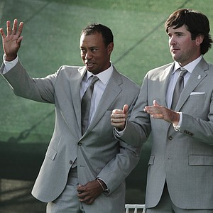 USA's Bubba Watson, right, watches as Tiger Woods is introduced during the opening ceremony at the Ryder Cup Thursday, Sept. 27, 2012, at the Medinah Country Club in Medinah, Ill.