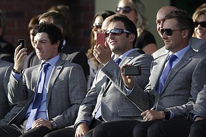 Europe's Rory McIlroy, Francesco Molinari and Ian Poulter take pictures during the opening ceremony at the Ryder Cup Thursday, Sept. 27, 2012, at the Medinah Country Club in Medinah, Ill.