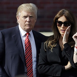 Donald Trump and his wife Melania Trump arrive for the opening ceremony at the Ryder Cup Thursday, Sept. 27, 2012, at the Medinah Country Club in Medinah, Ill.