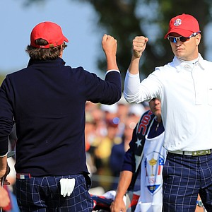 Jason Dufner and Zach Johnson of the USA celebrates a birdie putt on the 10th green during the morning foursome matches.