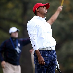 Tiger Woods of the USA reacts to a poor tee shot on the 15th hole during the morning foursome matches.