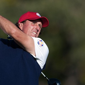 Phil Mickelson of the USA tees off on the 15th during the afternoon four-ball matches.